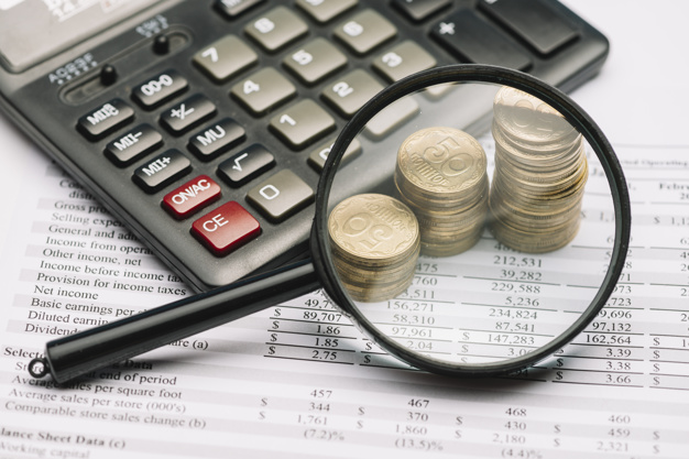 magnifying-glass-coin-stack-calculator-financial-report_23-2147919174